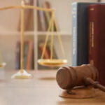 Legal items- gavel, scales of justice, legal books