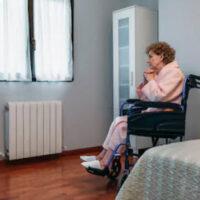 Lady inside nursing home room